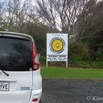 The Kiwimana mobile and Cafe Sign