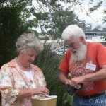 Donna and Dennis buy Raffle Tickets