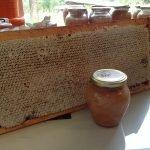 A fully capped honey frame and jar of Manuka honey